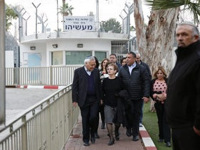 Moshe Katsav walks out of Ma'asiyahu Prison with his wife Gila, after being released on parole, December 21, 2016.