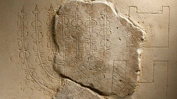 Menorah inscription from Herodian-era mansion, found in Jerusalem. Some believe this to be a faithful depiction of the Second Temple menorah but it's rather different from the one shown on Titus' Arch in Rome, which others believe to be the real faithful depiction of the Temple menorah.
