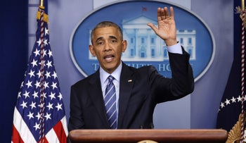 President Barack Obama waves at the conclusion of his news conference in the briefing room of the White House in Washington, Dec. 16, 2016.