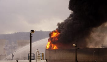 A fire that broke out in a fuel tank at Oil Refineries Ltd in Haifa, December 25, 2016.