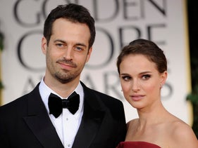 In this Sunday Jan. 15, 2012 file photo, Benjamin Millepied, left, and Natalie Portman arrive at the 69th Annual Golden Globe Awards in Los Angeles.