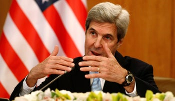 Kerry gestures during a news conference in Riyadh, Saudi Arabia December 18, 2016.