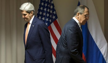 U.S. Secretary of State John Kerry and Russian Foreign Minister Sergey Lavrov walk to their seats for a meeting about Syria, in Zurich, Switzerland, January 20, 2016.