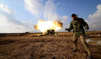 Members of the Popular Mobilization Forces fire towards ISIS positions in west of Mosul, Iraq, December 28, 2016.