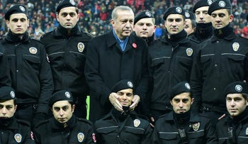 Turkish President Tayyip Erdogan poses with police officers before a soccer exhibition game at Besiktas Vodafone Arena in Istanbul, Turkey, December 22, 2016