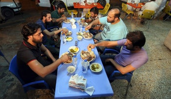 Customers eat pache at a restaurant in central Baghdad, Iraq, on October 30, 2016.