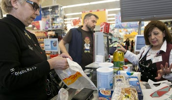 A shopper at the Super-Sol Deal store in Holon, January 1, 2017.