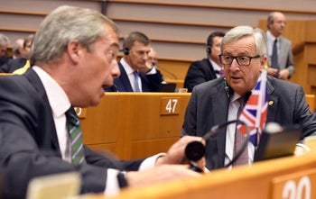 European Commission President Jean-Claude Juncker speaks with UKIP leader Nigel Farage during a special session of European Parliament in Brussels, Belgium, June 28, 2016.