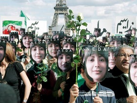 People hold placards bearing images of Iranian Neda Agha Soltan, the 27-year-old whose death beamed around the world on the Internet became a rallying cry for opponents of the regime, during a demonstration against Iran's clampdown on opposition activists, at the Trocadero near the Effeil Tower in Paris, Saturday, July 25, 2009.