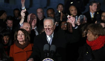 Senate Minority Leader Chuck Schumer (D-NY) and House Minority Leader Nancy Pelosi (D-CA) lead members of Congress during a protest on the steps of the U.S. Supreme Court January 30, 2017 in Washington, DC.