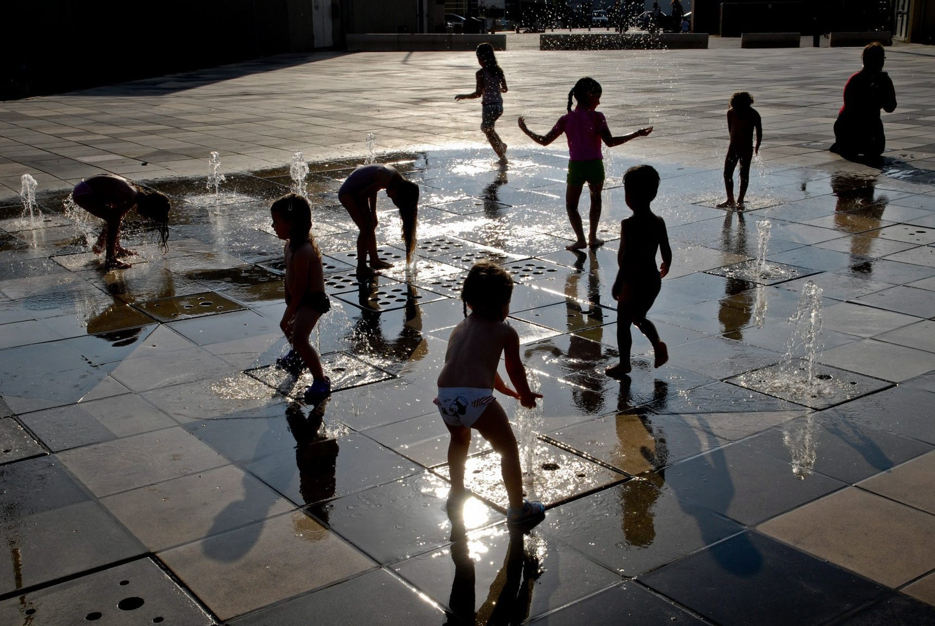 Kids playing in a fountain at Tel Aviv port.
