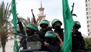 Members of Hamas' military brigade ride in a Gaza City parade on December 13, 2017.