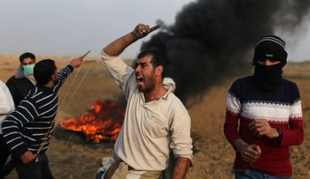 A Palestinian demonstrator reacts during clashes with Israeli troops in the southern Gaza Strip near the border with Israel, December 29, 2017.