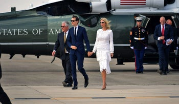Jared Kushner and Ivanka Trump make their way to board Air Force One before departing from Israel's Ben-Gurion International Airport, May 23, 2017.