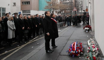 French President Emmanuel Macron and Paris Mayor Anne Hidalgo observing a minute's silence outside satirical newspaper Charlie Hebdo's former office, to mark the third anniversary of the attack, Paris, January 7, 2018.
