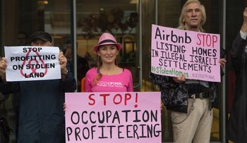 """A photo of protesters in the BDS-focused organization Code Pink, lead by Ariel Gold, coordinator of its """"justice for Palestine"""" campaign"""