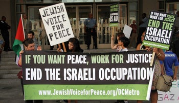 Members of Jewish Voice for Peace and Code Pink, both on Israel's newly announced BDS blacklist, participate in a demonstration against Israeli military operations in Gaza. Washington D.C. July 21, 2014