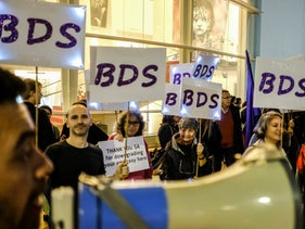 Pro-BDS activists at the anti-corruption protests in Tel Aviv. 23 December 2017