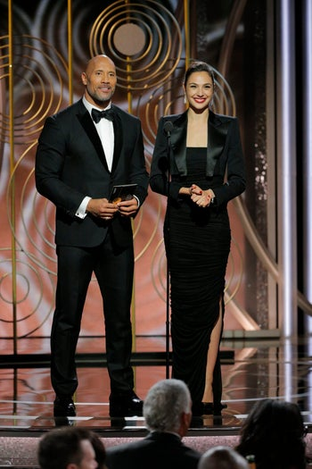 Gal Gadot and Dwayne 'The Rock' Johnson presenting the first award of the evening at the Golden Globes, January 7, 2018.