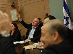 Members of the Knesset vote to temporarily postpone voting on the Supermarkets Bill, January 9, 2018.