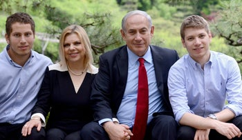 Prime Minister Benjamin Netanyahu (second from right), his wife Sara and their two sons Avner and Yair pose for a family picture during a tour of the temples in the city of Kyoto, Japa