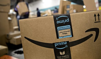 Illustration: An Amazon.com Inc. package being processed for delivery.