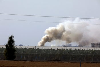 Smoke rising near the area where the Israeli army hit a cross-border attack tunnel in the Gaza Strip, December 10, 2017.