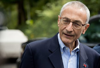 John Podesta speaking to members of the media outside Democratic presidential candidate Hillary Clinton's home in Washington, October 5, 2016.