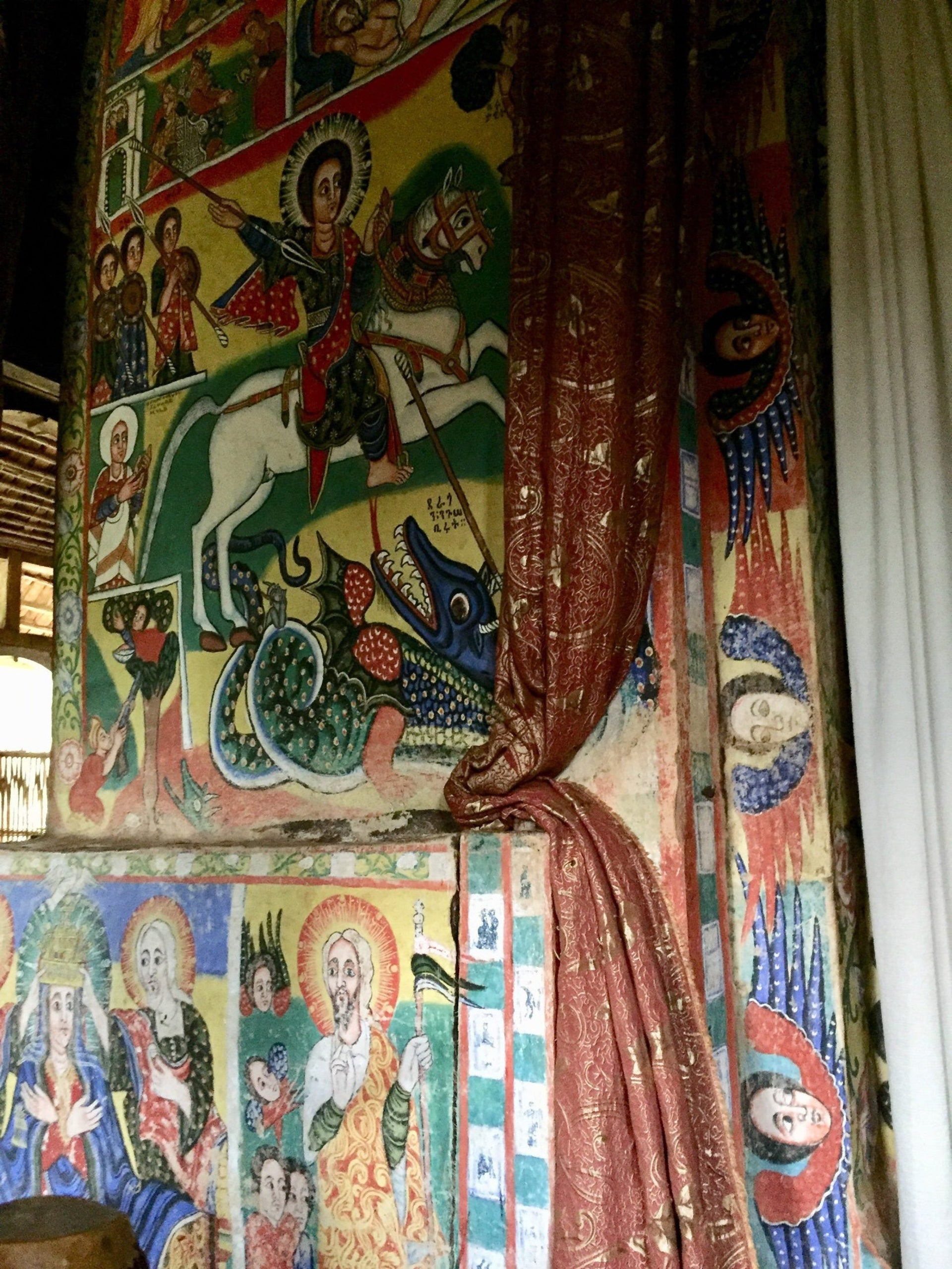 This Oct. 6, 2017 photo shows religious art at the interior of a circular, thatch-roofed church on an island in Lake Tana. The third-largest lake in Africa has long been home to Christian convents and monasteries.