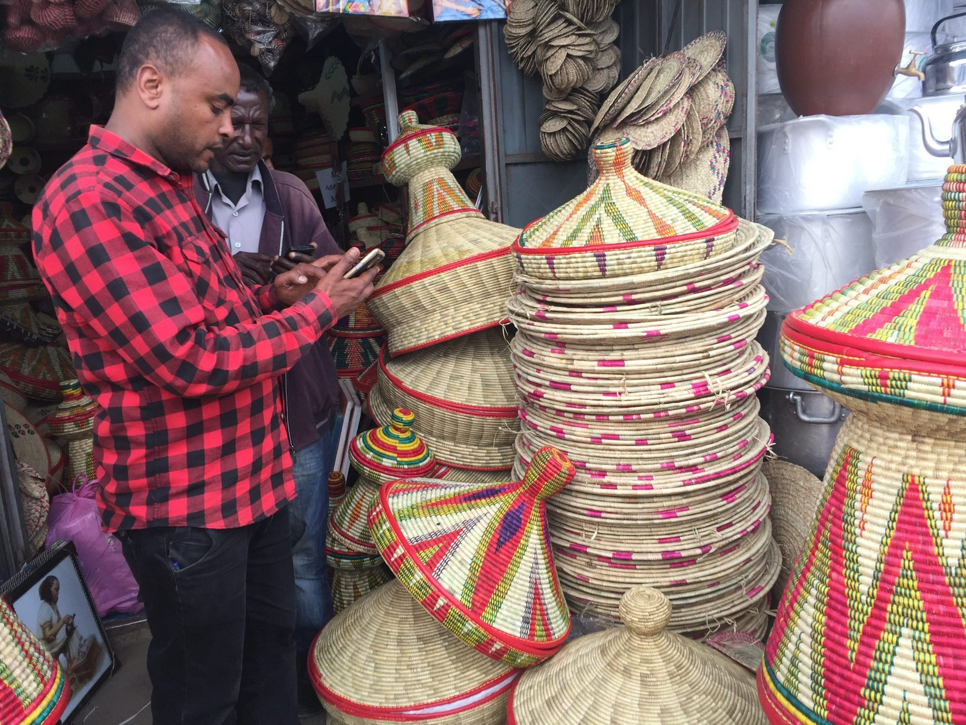 This Oct. 10, 2017 photo shows a colorful display of wares at the main market of Addis Ababa, capital of Ethiopia. The market is called the Merkato, a word borrowed from Italian and one of the few vestiges of Italy's short-lived colonization of Ethiopia in the 1930s. Another Italian invasion, in 1896, was repelled.