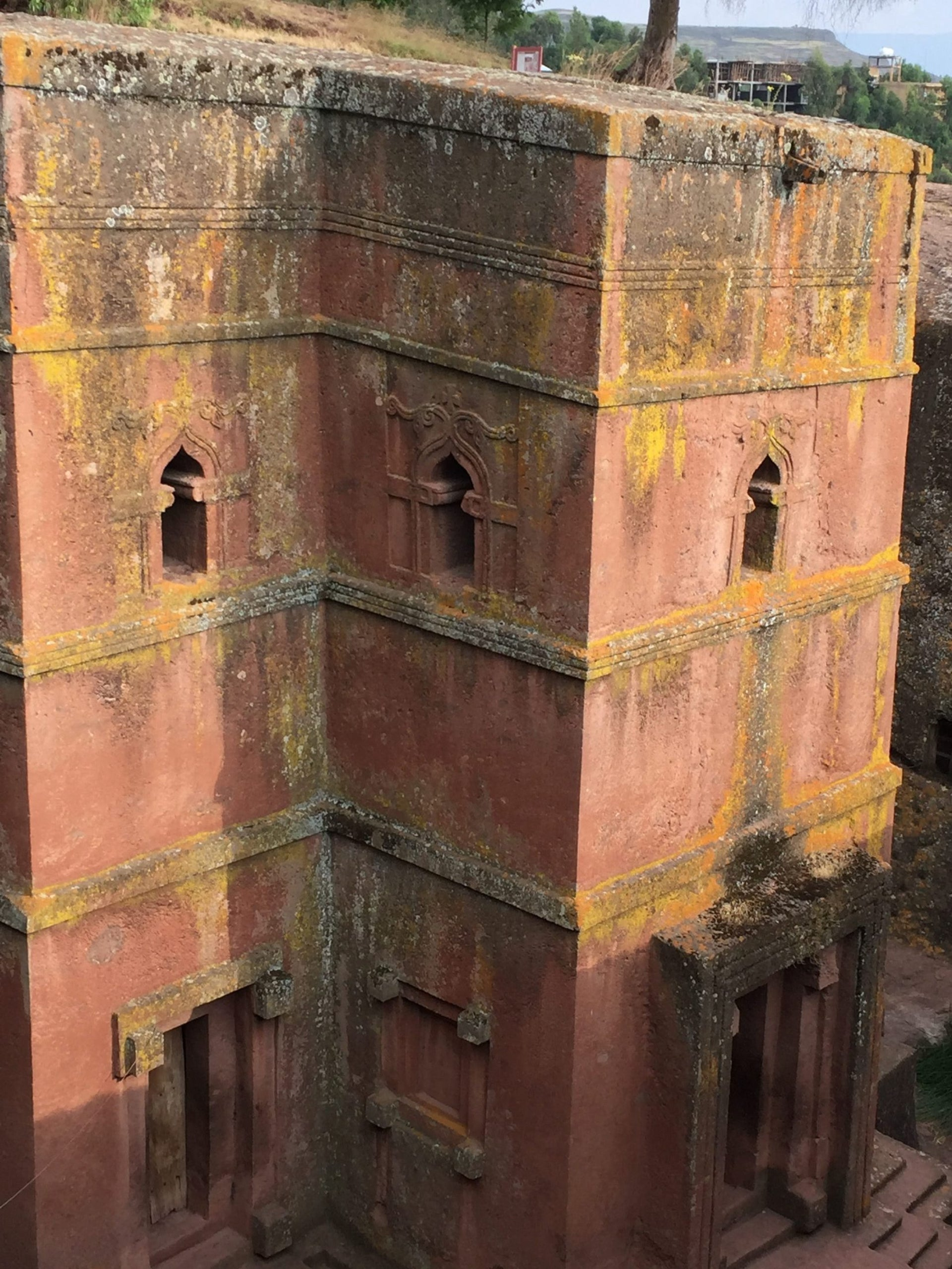 FILE - This Oct. 16, 2017, file photo, shows one of the 12th century churches carved from stone in Lalibela, Ethiopia. The architectural marvels are one of the country's most magical attractions, miracles of engineering built 8,000 feet above sea level, each carved in one piece directly from soft volcanic rock.