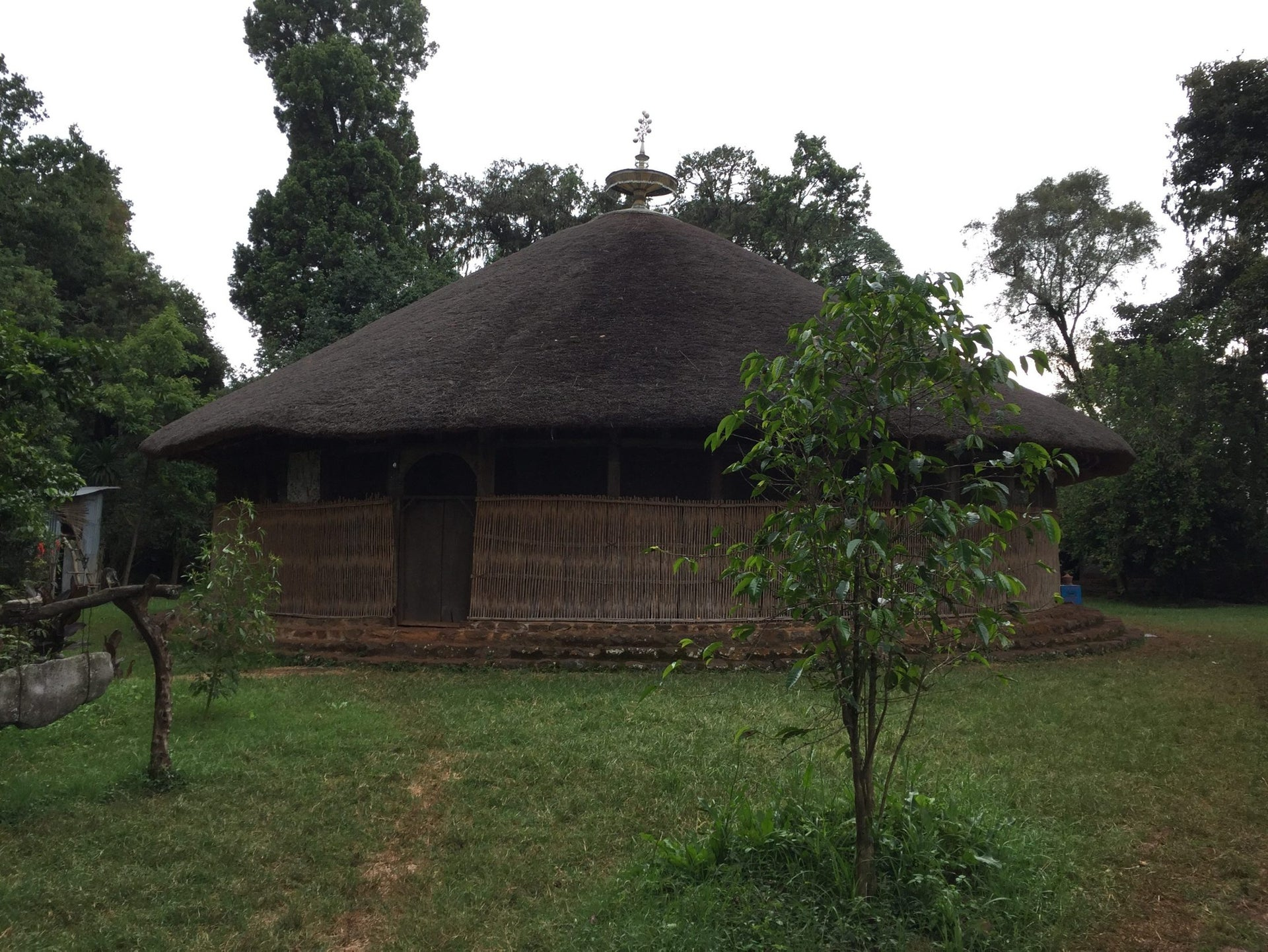This Oct. 6, 2017 photo shows a church located Lake Tana, Ethiopia. On some of the islets in Lake Tana, the third largest lake in Africa, are monasteries, convents and churches, attesting to Ethiopia's ancient and deeply rooted Christian faith. Contrasting with the simple exterior of this round, thatch-roofed church is an interior filled with exuberantly colored religious paintings. The suspended rock on the left emits a rich gong sound when struck, calling the faithful to prayer.
