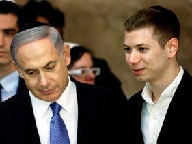 Israeli Prime Minister Benjamin Netanyahu and his son Yair visit the Western Wall in Jerusalem, March 18, 2015.