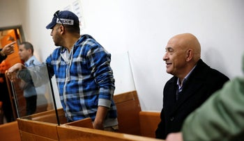 Israeli Knesset member Basel Ghattas sits at the Magistrates Court in Rishon Lezion, Israel December 23, 2016