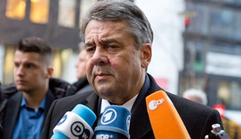 German Foreign Minister Sigmar Gabriel speaks with the media as he arrives for an EU3-Iran meeting at EEAS headquarters in Brussels, January 11, 2018.
