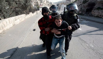 An undercover Israeli police officer and Border Police officers detaining a Palestinian youth on suspicion of throwing stones during clashes in the East Jerusalem neighborhood of Silwan in 2011.
