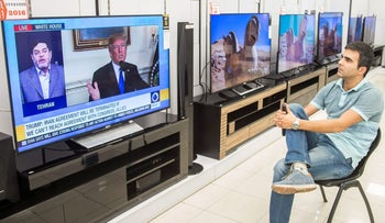 A man watches a television broadcast of U.S. President Donald Trump's speech, in Tehran, Iran October 13, 2017. Nazanin Tabatabaee Yazdi/TIMA via REUTERS ATTENTION EDITORS - THIS IMAGE WAS PROVIDED BY A THIRD PARTY.