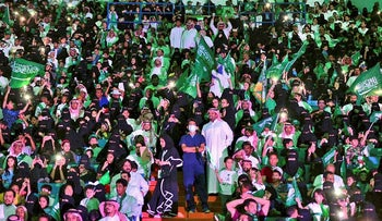 In this Sept. 23, 2017 file photo released by Saudi Press Agency, SPA, Saudi men and women attend national day ceremonies at the King Fahd stadium in Riyadh, Saudi Arabia