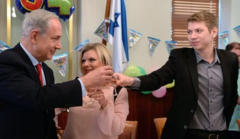 Prime Minister Benjamin Netanyahu with his wife, Sara, and their eldest son, Yair, 2013.