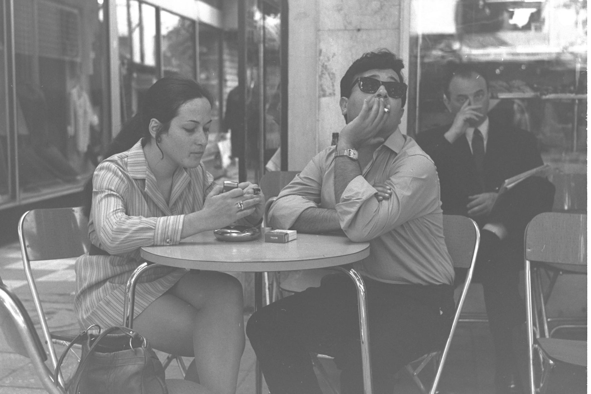 A couple at a café  on Dizengoff Street, Tel Aviv in the 1960s.
