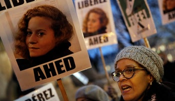 A demonstrator hold a poster that reads: 'Release Ahed' during a protest demanding the Palestinian teen's release in Paris on January 4, 2018.