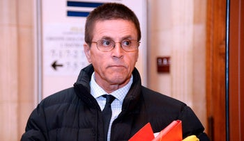 Hassan Diab, who was arrested in November 2008 for his alleged role in a 1980 Paris synagogue bombing, arrives at the courthouse, Paris, May 24, 2016.
