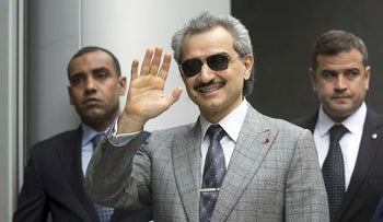 Prince Alwaleed Bin Talal, Saudi billionaire and founder of Kingdom Holding Co., center, waves as he arrives to give evidence at the High Court in London, U.K., on Tuesday, July 2, 2013