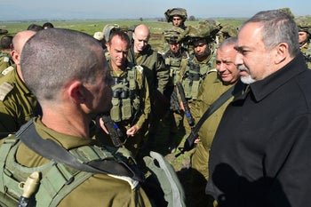 Defense Minister Avigdor Lieberman, accompanied by Chief of Staff Gadi Eisenkot during a visit to a military exercise in the Golan Heights in 2017.