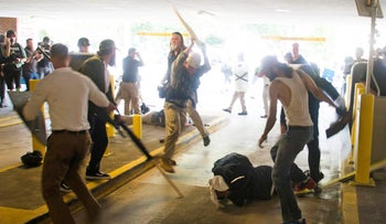 DeAndre Harris is assaulted by participants in the 'Unite the Right' white nationalist rally, in a parking garage beside the Charlottesville police station. Harris suffered a head laceration, concussion, a knee injury, a fractured arm, internal injuries and a spinal injury. Aug. 12, 2017