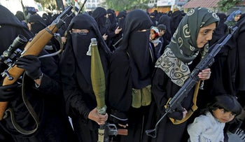 Women hold weapons as they attend a rally to show support to the Houthi movement in Sanaa, Yemen January 13, 2018.