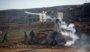 Palestinian clash with Israeli forces in the village of Qusra, in the West Bank Dec. 1, 2017