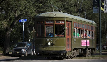 A St. Charles Streetcar carries passengers through the Uptown neighborhood of New Orleans, Louisiana, U.S., on Tuesday, Oct. 21, 2014