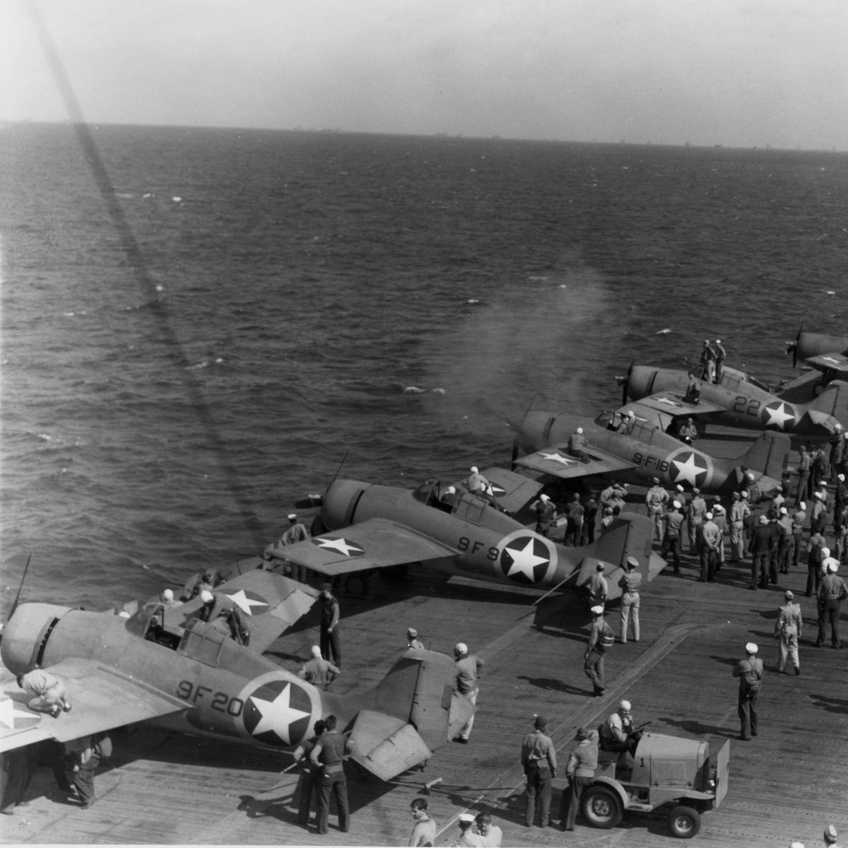 "U.S. Navy Grumman F4F-4 Wildcat fighters of Fighting Squadron 9 (VF-9) and VF-41, Carrier Air Group Four (CVG-4), testing guns aboard the aircraft carrier USS Ranger (CV-4) in early November 1942, prior to taking part in ""Operation Torch"", the Allied invasion of North Africa."