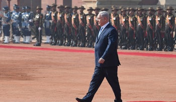Israeli Prime Minister Benjamin Netanyahu walks back after inspecting a guard of honor during a ceremonial reception at the Presidential Palace in the Indian capital New Delhi on January 15, 2018